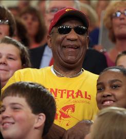An icon for kids, too: Bill Cosby with a group of Pennsylvania schoolchildren in August at the state Capitol in Harrisburg, where he helped celebrate improvements in students' standardized test scores.
