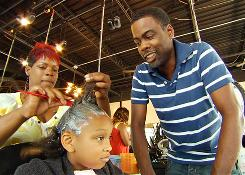 """Already addicted to """"creamy crack"""": Chris Rock watches a girl get her hair relaxed in Good Hair. He criticizes the practice for young girls."""