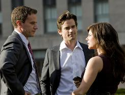 Matt Bomer, center, plays a con man who works with an FBI agent (Tim DeKay) and his wife (Tiffani Thiessen).