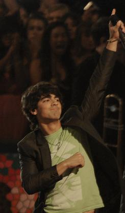 Burnin' up ticket sales: Joe Jonas and the Jonas Brothers.