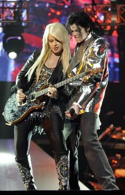Starting something: Orianthi jams with Michael Jackson in This Is It, the documentary that hits theaters this week.