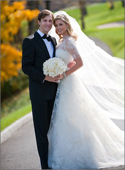 Ivanka Trump and Jared Kushner pose at their wedding at Trump National Golf Club on Sunday.