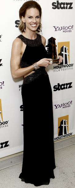 Hilary Swank poses with her award for actress of the year backstage at the 13th Annual Hollywood Awards Gala.