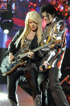 Jackson practices with lead guitarist Orianthi in the This Is It documentary. Orianthi, from Australia, had been invited by Jackson's musical director after her performance at the Grammys in February.