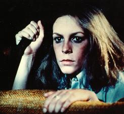 Halloween: Jamie Lee Curtis vs. slasher Michael Myers, accompanied by tinkling, ominous music.