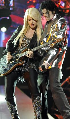 Michael Jackson and Orianthi In a scene from This Is It.