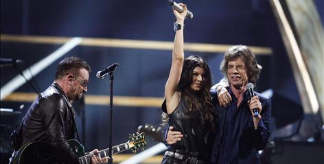 Taking Shelter to a fevered pitch are Bono, left, and U2 performing with Mick Jagger, the head Stone, and Fergie of the Black Eyed Peas.