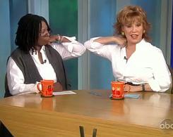 "Elbow bump: Whoopi Goldberg and Joy Behar of The View demonstrate the ""preferred"" flu-season greeting."