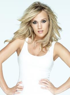 No slowing down: Carrie Underwood will co-host the Country Music Association Awards on Nov. 11. Her new album, Play On, arrives Tuesday.