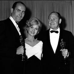 At the Oscars, April 1962: Presenter Debbie Reynolds with Henry Mancini, left, and Johnny Mercer, best-song winners for Moon River.
