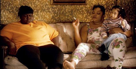 Precious (Gabourey Sidibe), left, is locked in a destructive relationship with her mother, Mary (Mo'Nique).