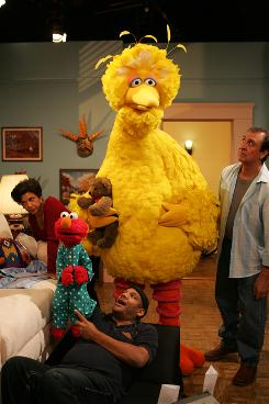 Maria (Sonia Manzano), left, Elmo (Kevin Clash), Big Bird (Caroll Spinney ) and Luis (Emilio Delgado) rehearse on the set of Sesame Street.