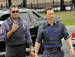 Vested interest: Laurence Fishburne's Dr. Ray Langston, left, pops over to New York to work with Gary Sinise's Mac Taylor on CSI:NY Wednesday.