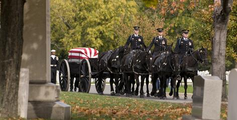Solemn procession: Caissons drawn by horses and bearing a flag-draped casket are common scenes at Arlington National Cemetery. The grounds often have as many as 27 burials a day, five days a week.