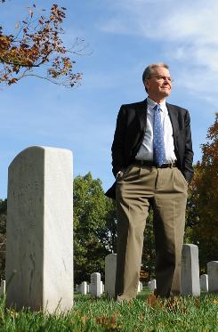 Walk through history: Robert Poole stands amid graves at Arlington National Cemetery, the subject of On Hallowed Ground, out in time for Veterans Day.