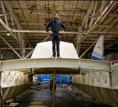 Green captain: David de Rothschild's catamaran Plastiki, which is under construction in San Francisco, is made of recycled plastic. He and a crew will try to sail next month across the Pacific to Sydney.