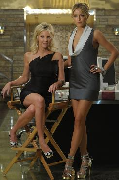 On the set: Heather Locklear, left, returns as Amanda, now a PR firm partner who will mentor Katie Cassidy's Ella on CW's Melrose Place.