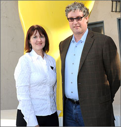 Contest winner Peggy Black poses with Simpsons producer Al Jean. Her newly created  character will debut  Jan. 31. Here's hoping ladies' man Ricardo Bomba goes over better than Poochie.