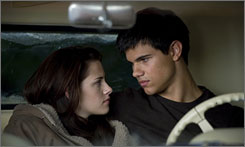 Kristen Stewart, left, plays Bella and Taylor Lautner plays werewolf friend Jacob in The Twilight Saga: New Moon.