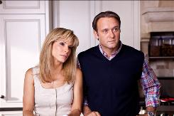 In The Blind Side, Sandra Bullock and Tim McGraw play Leigh Anne and Sean Tuohy, the adoptive parents of football player Michael Oher.