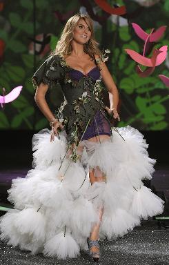 Host on the runway: No bra and panties for supermodel Heidi Klum. She went with an over-the-top, cover-up-girl number.