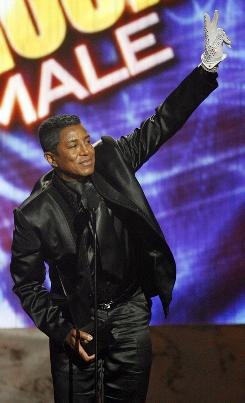 Jermaine Jackson accepts the award for favorite pop/rock male artist for his late brother, Michael Jackson, at the American Music Awards.