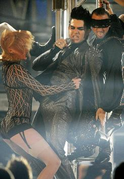 Adam Lambert  and dancers perform at the 2009 American Music Awards on Sunday, which garnered big ratings for ABC.