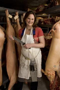 Julie Powell stands inside a meat freezer at Fleischer's Grass-Fed, Organic Meats, a Kingston, N.Y. butcher shop. Powell, the author of Julie and Julia, has a new memoir out Tuesday. In Cleaving, she writes about becoming an apprentice butcher and her relationship with her husband.