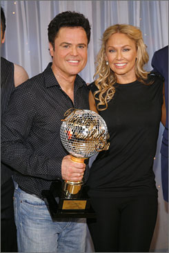 Dancing pro Kym Johnson, right, helped Donny Osmond take home the disco ball of glory in this round of Dancing With the Stars.