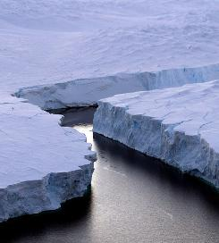 Cold, hard facts, scientists say: An iceberg breaks off the Knox Coast in the Australian Antarctic. Melting polar ice is frequently cited as proof of climate change.