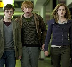 Harry Potter (Daniel Radcliffe), Ron Weasley (Rupert Grint) and Hermione Granger (Emma Watson) have disrobed in favor of a casual look for a jaunt in London, here near Piccadilly Circus. Deathly Hallows is the first of the final two Potter films.