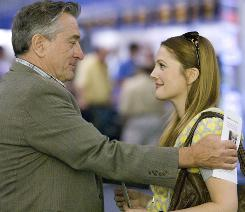 A father-and-child reunion: Stoic father Robert De Niro visits bubbly daughter Drew Barrymore in Las Vegas.