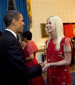President Obama greets Michaele Salahi at a state dinner Nov. 24 at the White House. She and her husband, Tareq, deny they crashed the party, but they weren't on the guest list. The couple's photos with Obama and other officials showed up on the Salahis' Facebook page.