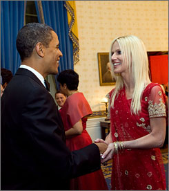 Hello!: President Obama greets Michaela Salahi at a state dinner Nov. 24 at the White House. She and her husband, Tareq, deny they crashed the party, but they weren't on the guest list. The couple's photos with Obama and other officials showed up on the Salahis' Facebook page.