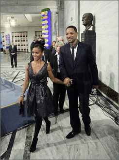 """Just another awards show? Jada Pinkett Smith and Will Smith say they want to host the Nobel concert as if it's """"in our living room."""" The couple is shown here arriving for the Nobel Peace Prize ceremony in Oslo on Thursday."""