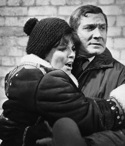 Actor Gene Barry with co-star Joan Collins in the film Subterfuge. Barry died Wednesday, his son told the Associated Press.