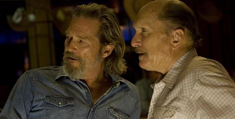 Constantly raising the bar: Jeff Bridges, left, with Robert Duvall in Crazy Heart, plays Bad Blake, a fallen country star who is eking out a living and looking for love with single mother Maggie Gyllenhaal.