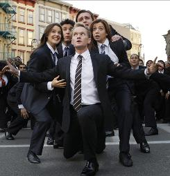 Neil Patrick Harris leads Cobie Smulders, left, Josh Radnor, Jason Segel and Alyson Hannigan in Nothing Suits Me Like a Suit.
