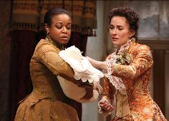 Quincy Tyler Bernstine, left, and Laura Benanti star in In the Next Room, a play about a physician, the women in his life and a newfangled contraption.