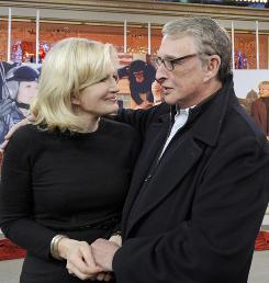 Goodbye, Good Morning: Host Diane Sawyer with husband Mike Nichols after the Dec. 11 broadcast, her last. 