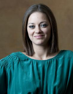 Marion Cotillard: Plays Luisa, the wife.