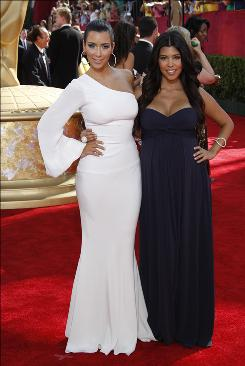 Kim, left, and Kourtney Kardashian, stars of the reality show Keeping Up With the Kardashians, on the red carpet at the Primetime Emmy Awards.