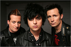 Green Day : Tre Cool, left, Billie Joe Armstrong and Mike Dirnt .
