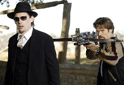 In cross hairs: Ethan Hawke, left, and Willem Dafoe make their way through a vampire-riddled world.
