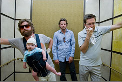 Three men and a baby, redux:  Zach Galifianakis, left, Bradley Cooper and Ed Helms in a scene from The Hangover.