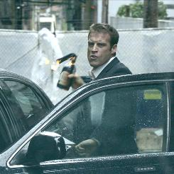 In the line of fire: Christopher Chance (Mark Valley) is the human target in the title, a private contractor hired to protect clients from danger.