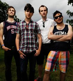 Sophomore effort: Christopher Tomsom, left, Ezra Koenig, Chris Baio and Rostam Batmanglij integrate reggaeton, dancehall, ska-punk and funk styles into Contra.