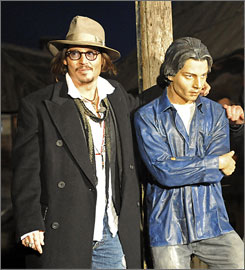 Johnny Depp poses with his static counterpart in the a Serbian mountain community on Wednesday.