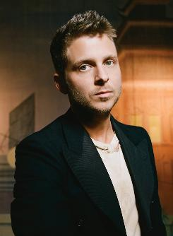 All over the place: Songwriter, singer and musical producer Ryan Tedder.