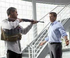 It's a dangerous job ... But Christopher Chance (Mark Valley), right, has to do it, even if it means dealing with a gun-toting Hollis (Mark Moses).